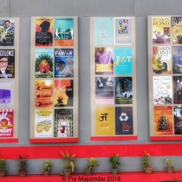 Books on display on a wall